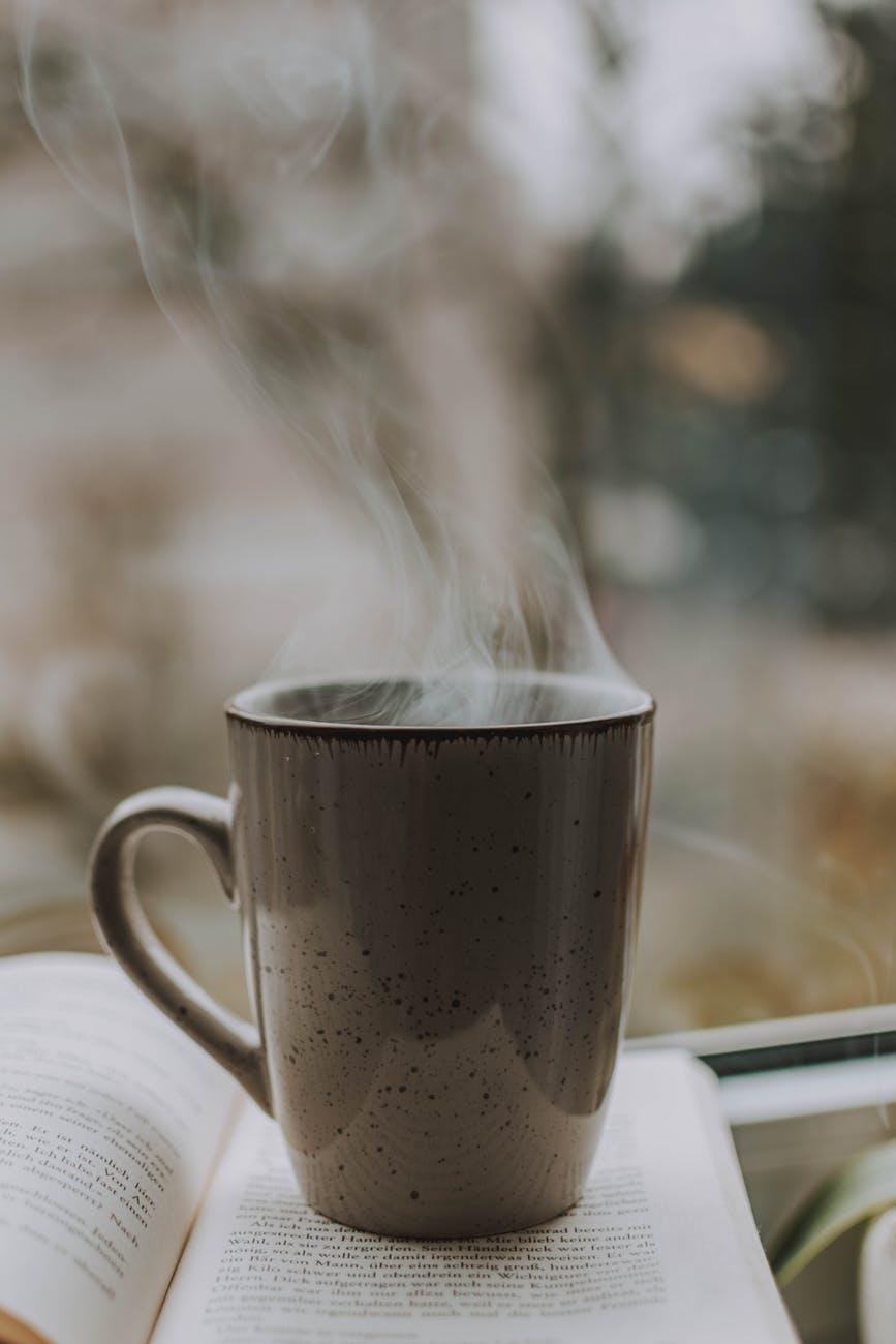 photo of coffee mug on top of book
